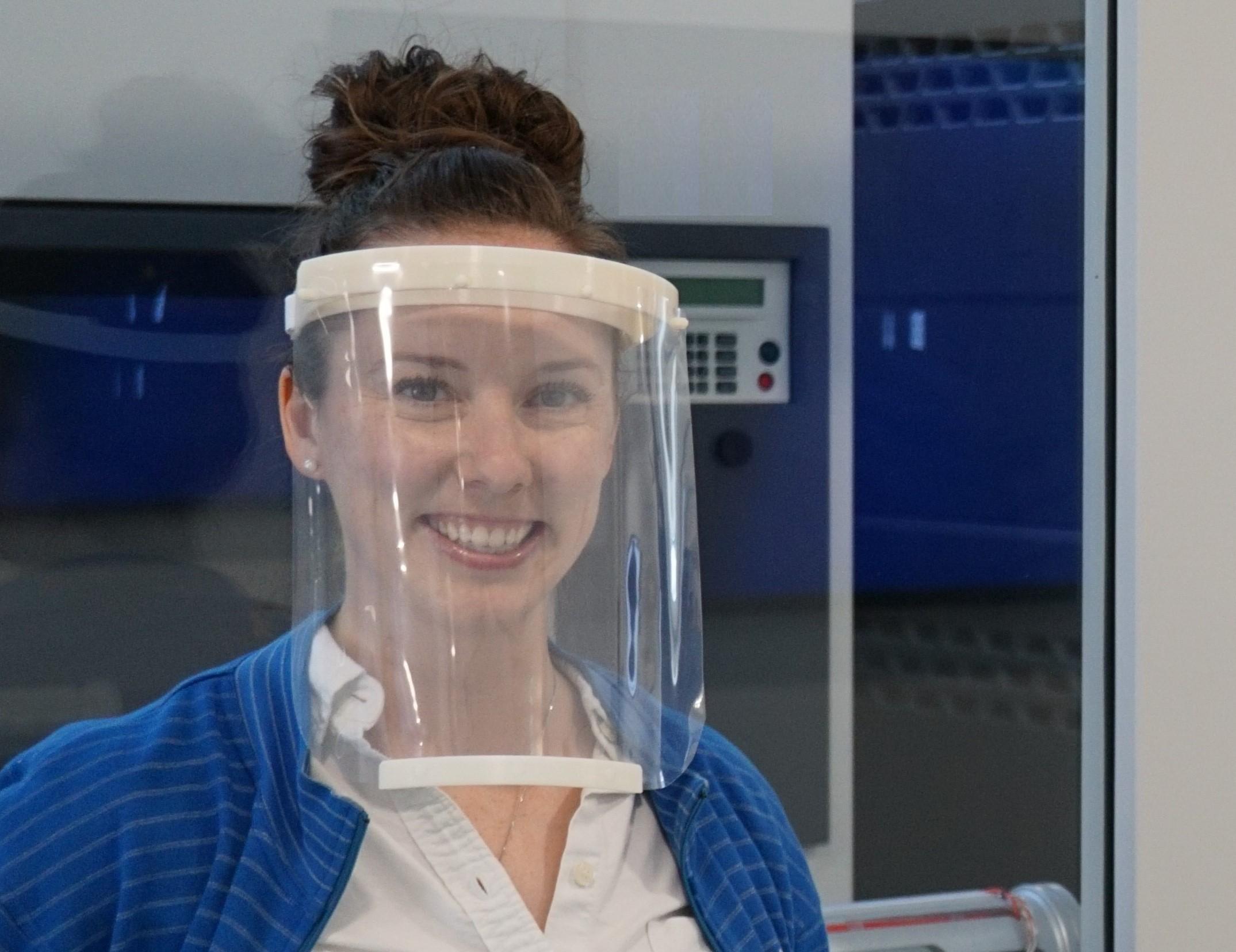 Female Baker Hughes employee wearing a face shield