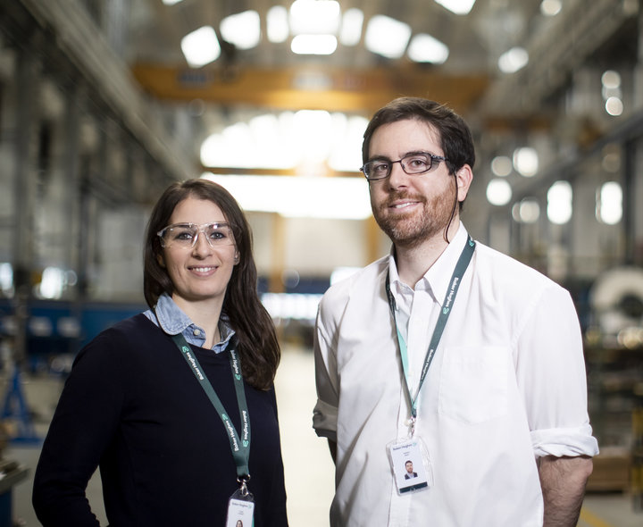 Portrait of two Baker Hughes employees