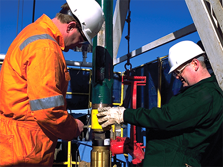 Two Baker Hughes employees at a rig site