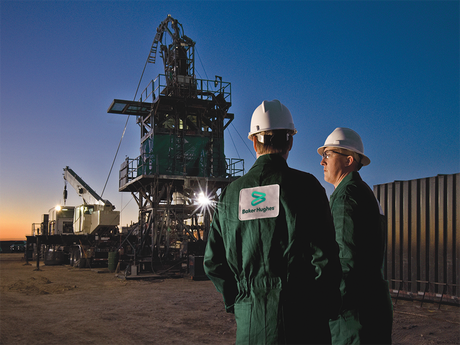 Two Baker Hughes employees at a coiled-tubing rig site