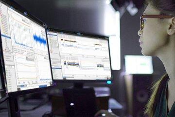 Female analyzing data on computer