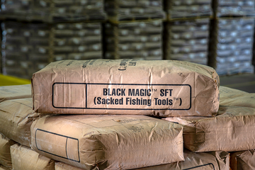 Photo of a bag of BLACK MAGIC spotting fluids in the warehouse.