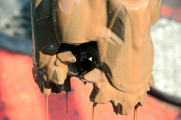 Photo of a drill bit with water based drilling mud on it.