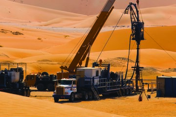 Photo of a rig site in the desert.