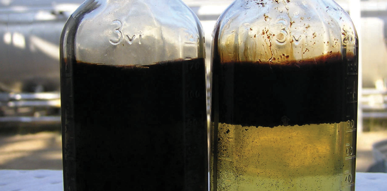 photo of two bottles with oil separation