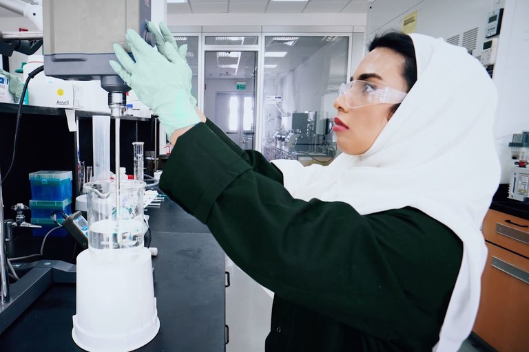 woman in PPE working in a BH labratory